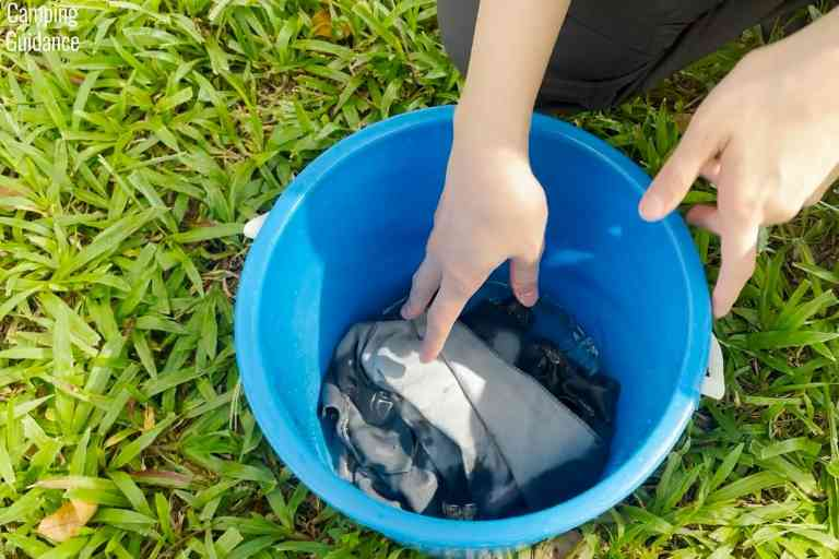 Soaking the Sea to Summit Drylite towel in a bucket to test its absorbency.