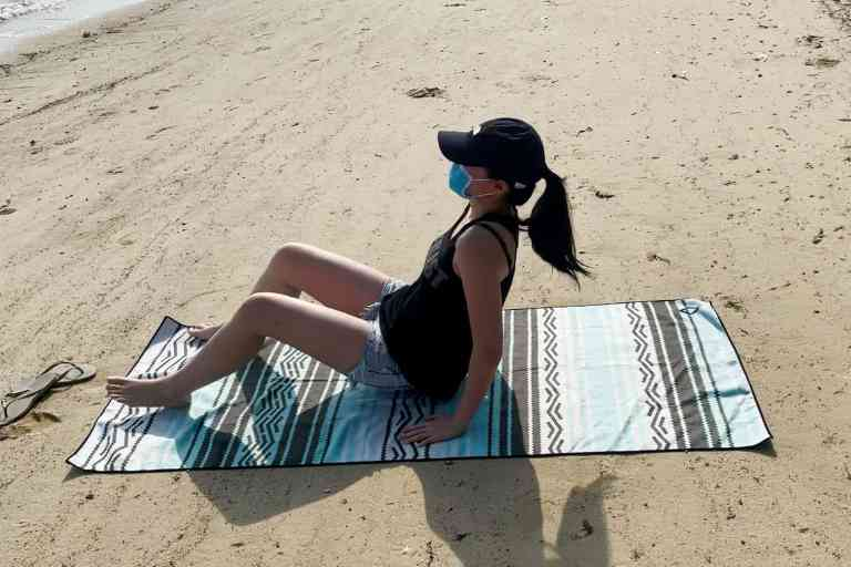 Using the Nomadix towel (71 x 30 inches) while at the beach.