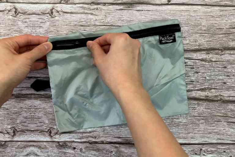 The PackTowl Personal's storage pouch is lightweight with good quality zippers.