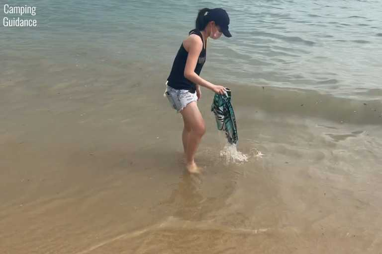 Soaking the Nomadix Original Towel in seawater to test its odor resistance.