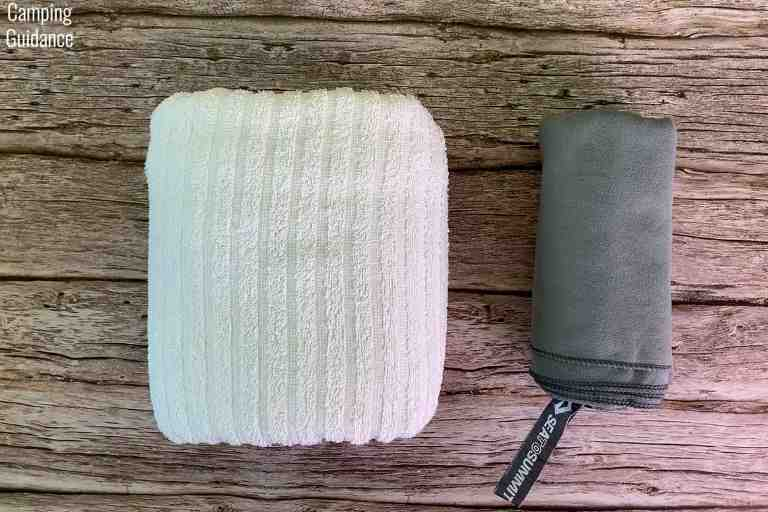 The Sea to Summit Drylite Towel beside a similar-sized cotton towel for a packed size comparison.