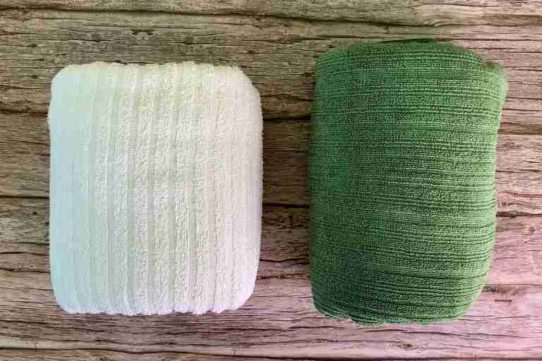 Putting a cotton towel (left) and the PackTowl Luxe (right) side by side for a packed size comparison.