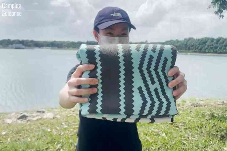 The Nomadix Original towel folded up; it's compact for such a large Beach-sized towel.