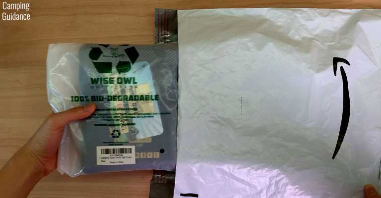 Removing the Wise Owl Towel (still in plastic packaging) from the Amazon package.