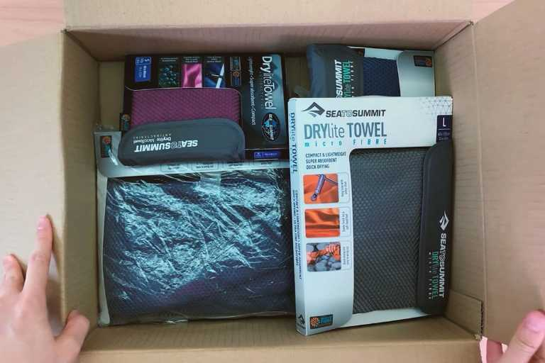 Sea to Summit Drylite towels in an Amazon box.