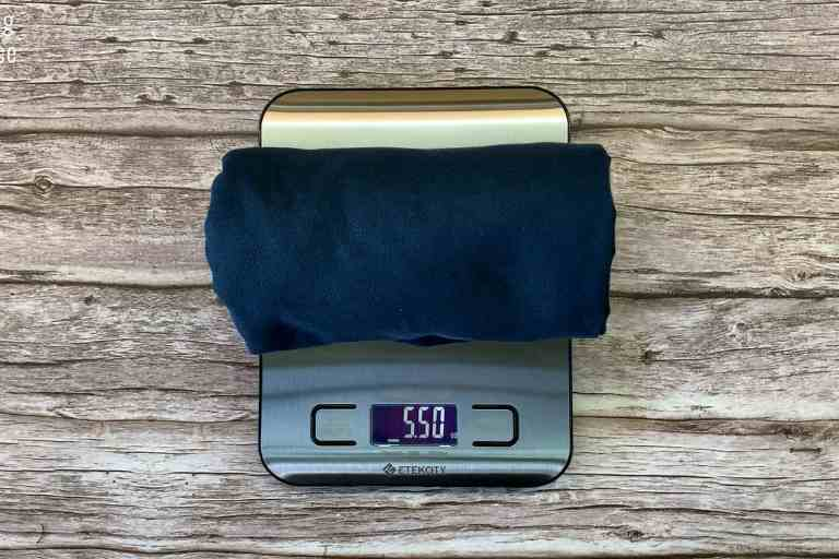 Weighing the Rainleaf Microfiber towel on a weighing scale, in ounces - 5.5 ounces.