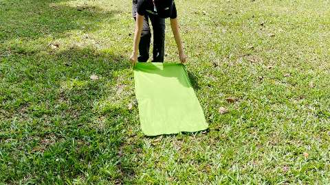 Dragging the Sea to Summit Pocket Towel along some grass.