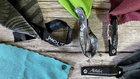 Hanging loops of all the backpacking towels. From bottom left: Sea to Summit AirLite, PackTowl UltraLite, Sea to Summit Pocket, Matador NanoDry Shower, Matador NanoDry Trek.