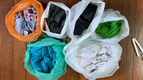 Testing the odor resistance of each backpacking towel by sealing it in plastic bags. The Matador NanoDry Towel was tested separately with the camping towel review.