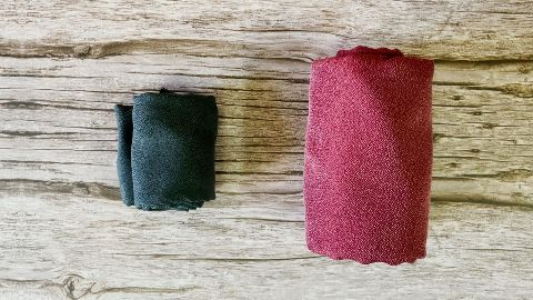 Packed size of the Matador NanoDry Trek Towel (left) beside the Shower Towel (right).