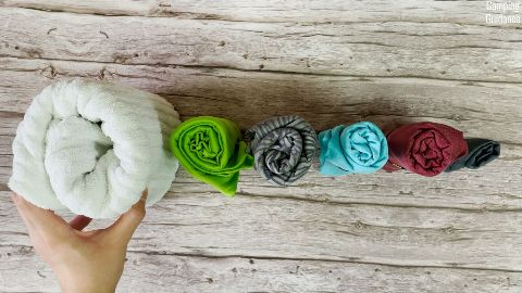 Top view, from left to right: Cotton towel, Sea to Summit Pocket Towel, PackTowl UltraLite, Sea to Summit AirLite Towel, Matador NanoDry Shower Towel, Matador NanoDry Trek Towel