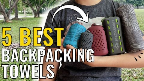 Me holding all 5 backpacking towels. From left to right: Sea to Summit AirLite Towel, Matador NanoDry Trek Towel, Matador NanoDry Shower Towel, Sea to Summit Pocket Towel, and PackTowl UltraLite.