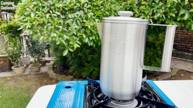 Brewing coffee outdoors with the Stanley Camp Percolator and the Coleman Portable Butane Stove.