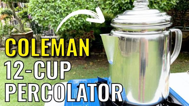 Brewing coffee outdoors with the Coleman 12-Cup Stainless Steel Coffee Percolator.