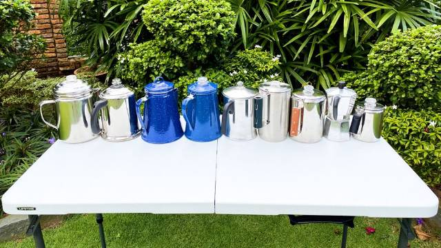 The 9 best camping percolators from left to right: Coleman 12-Cup Stainless Steel Percolator, Farberware Yosemite 8-Cup Percolator, Stansport Enamel 8-Cup Percolator, GSI Outdoors 8-Cup Enamelware Percolator, Primula Today 9-Cup Aluminum Percolator, Stanley Camp 6-Cup Percolator, Coletti Bozeman 9-Cup Camping Percolator, Bialetti 6-Cup Moka Express, and the GSI Outdoors Glacier 3-Cup Percolator.